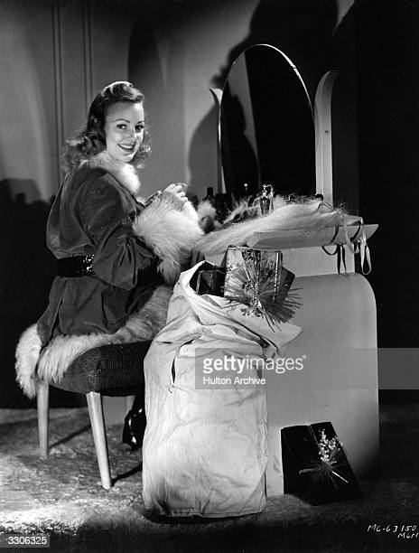 Virginia Gray the Hollywood film star and actress signed by MGM is seen preparing herself for the role of St Nicholas so that she can distribute...