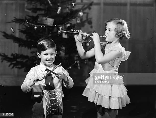 Children play with the musical instruments they received from Santa for Christmas