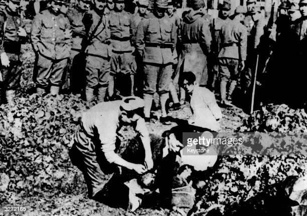 Five Chinese prisoners of war are buried alive by their Japanese captors just outside Nanking after the fall of the Chinese capital