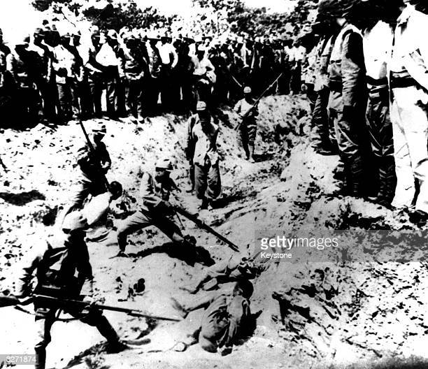 Japanese recruits at bayonet drill using Chinese prisoners as targets after the capture of the Chinese capital Nanking during the SinoJapanese...