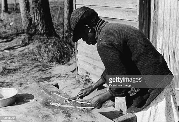 A woman preparing chitlins a dish made with the smaller intestines of a pig after a hog killing near Maxton North Carolina