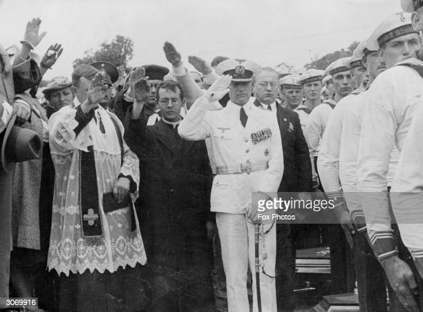 Commander Langsdorf and German ministers at the burial of the German sailors killed on the Graf Spee the battleship which was scuttled during the...