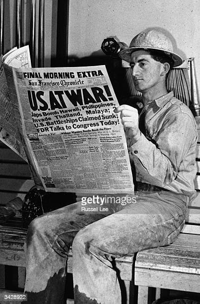 A man reading an account of the bombing of Pearl Harbour in the San Francisco Chronicle at the Shasta Dam in California