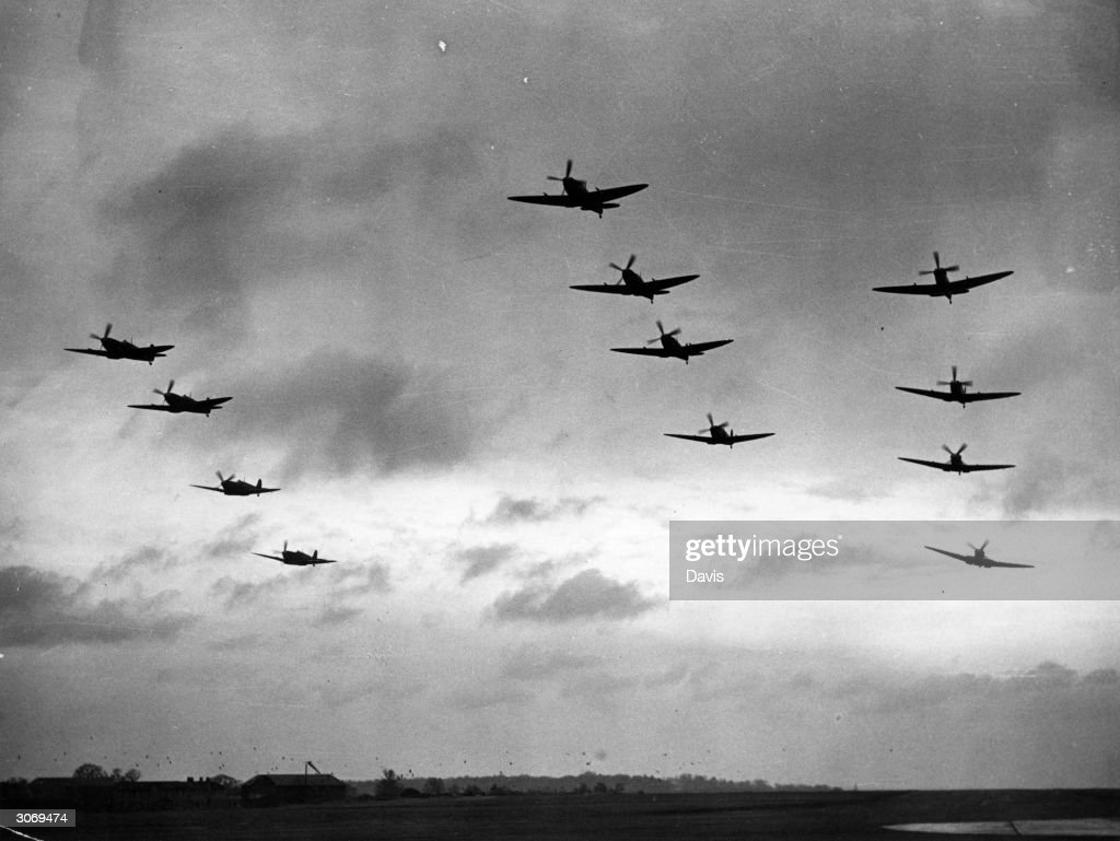 A squadron of Spitfire fighterplanes taking off.