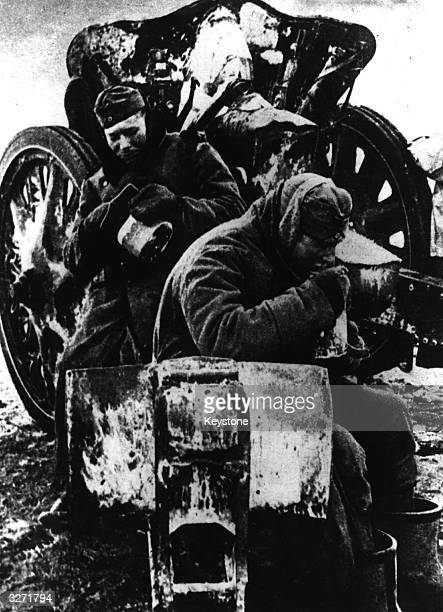 Two cold Germans soldiers sit on their field gun The Nazi armies were retreating before the Russian winter offensive pushing back from the Don River...