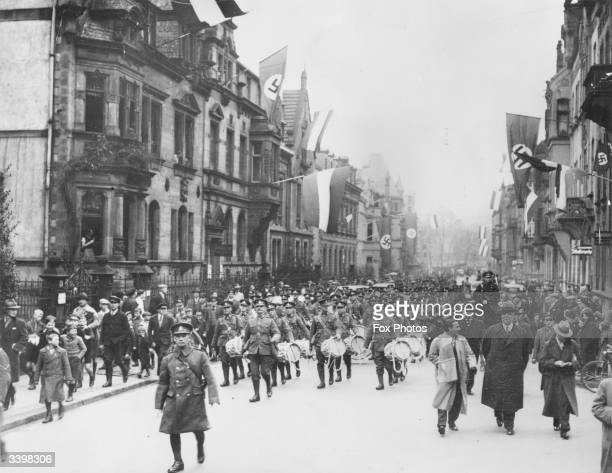 British troops arriving in Saar Germany as swastikas still fly from houses