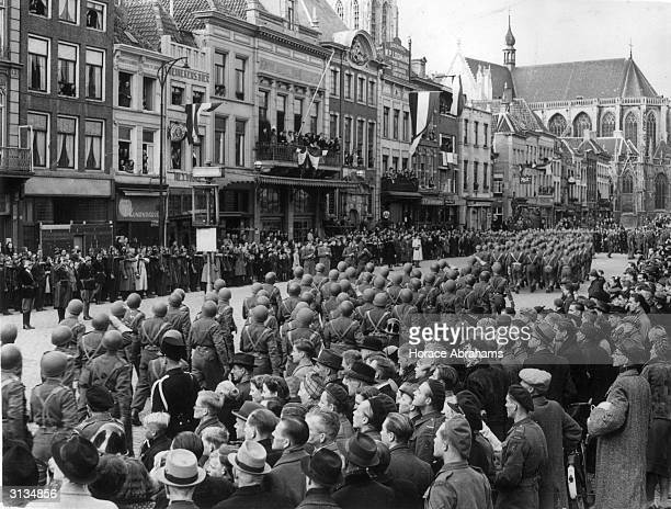 Soldiers of the 1st Polish Armoured Division form a triumphant procession through the streets of Breda in the Netherlands after liberating the city...