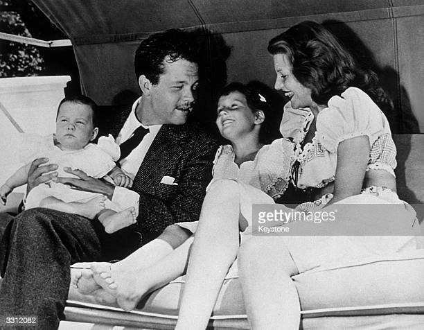 Rita Hayworth and her husband Orson Welles with their children Rebecca and Christopher Welles' daughter with Virginia Nicholson