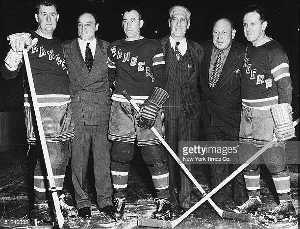 December 1947 Members of the New York Rangers hockey team gather to honor Lester Patrick who was their first manager at Madison Square Garden New...