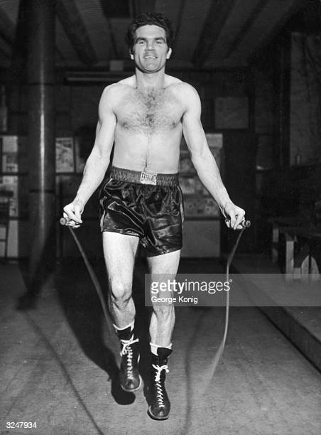 English boxing champion Freddie Mills winner of the 1948 World Light Heavyweight title keeps in shape at his London gymnasium He is preparing to meet...