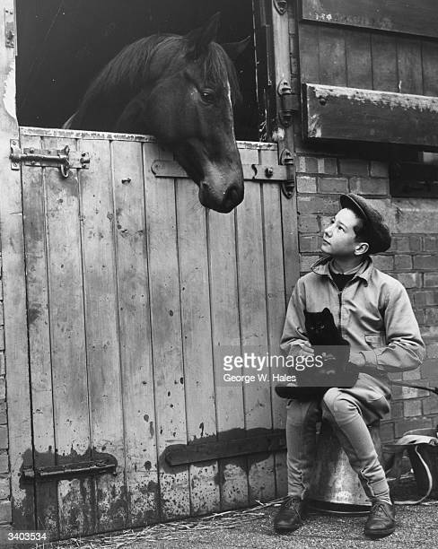 Apprentice jockey Lester Keith Piggott at his father's training stable at Lambourn 1950's most successful apprentice jockey Piggott rode his first...