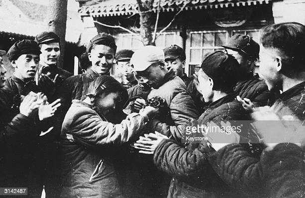 University volunteers are given a rousing send off by fellow students as they leave Peking for the Korean War.