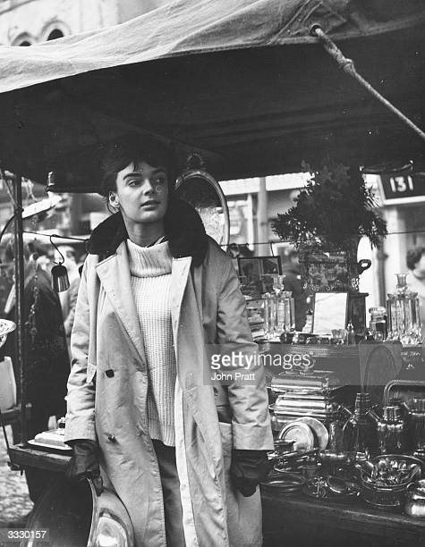Film actress Barbara Steele on duty at a stall in Portobello Road market west London