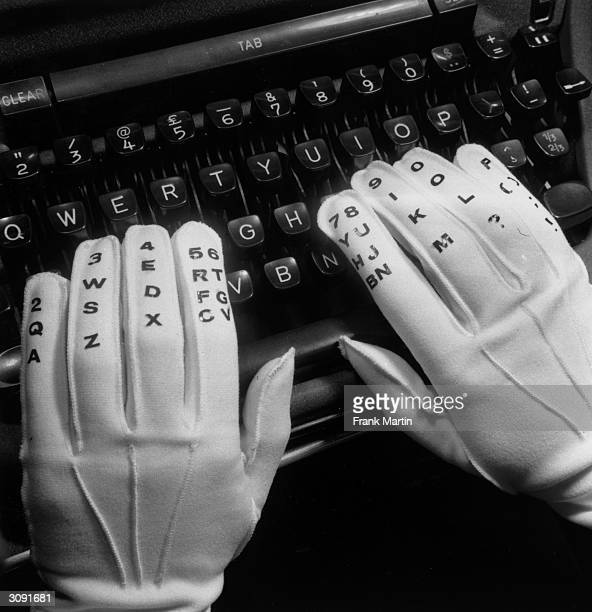 Close-up of the lettered and numbered gloves used for teaching touch typing.