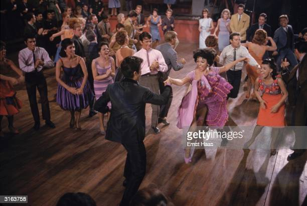 Rita Moreno and George Chakiris demonstrate their dancing ability in a scene from 'West Side Story' directed by Robert Wise and Jerome Robbins