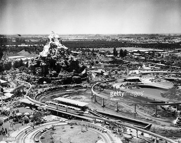 The autopia freeway and a 14 storey model of the Matterhorn mountain at Disneyland in California.