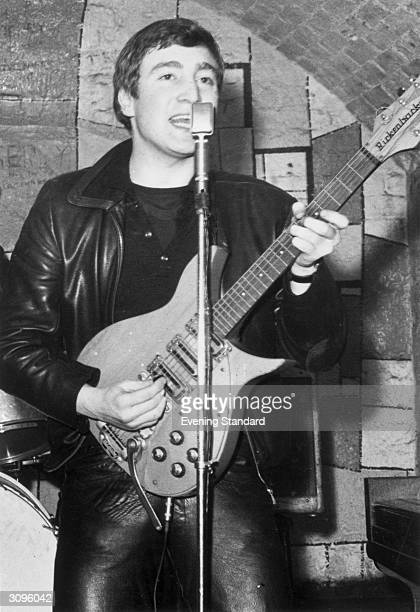 Singer guitarist and songwriter John Lennon of the British group The Beatles live on stage at the Cavern Club in Matthew Street Liverpool