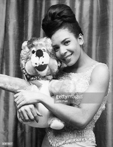 Singer Shirley Bassey embraces a soft toy