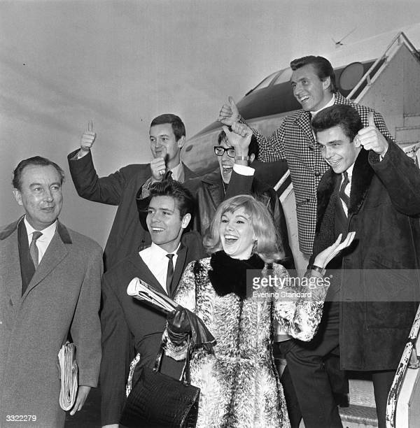 English actress Susan Hampshire and instrumental group The Shadows, including Cliff Richard and Hank Marvin .