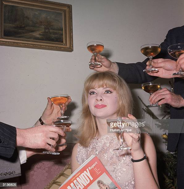English call girl Mandy Rice Davies made famous by her involvement in the Profumo affair at a party to launch her book 'The Mandy Report'