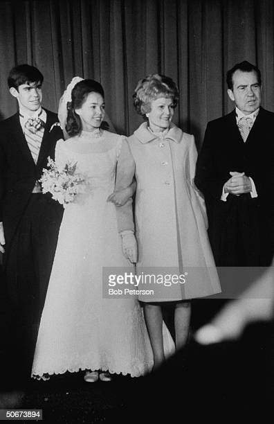 Husband David Eisenhower and wife Julie after their wedding ceremony with her parents Presidentelect Richard Nixon wife Pat