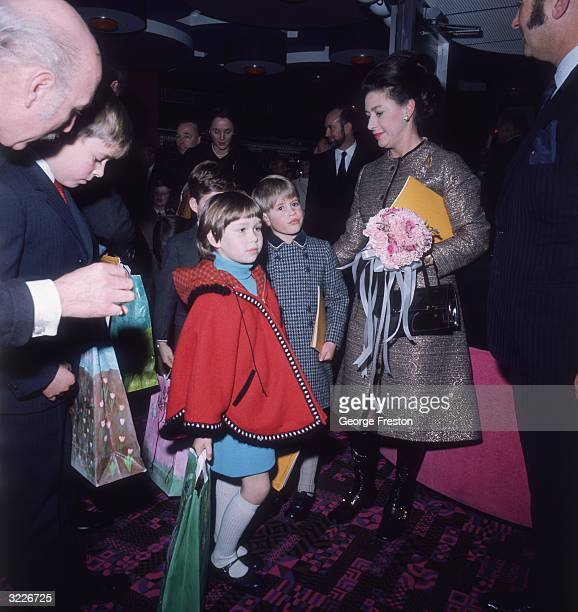 Princess Margaret with children of the Royal family at a special premiere of 'The Railway Children'