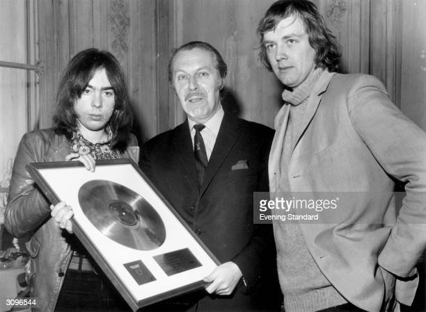 Anthony Grant presenting the British composer Andrew Lloyd Webber and his partner and lyricist Tim Rice with the Gold and Platinum discs for their...