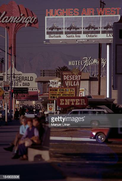 USA December 1971 Las Vegas On the 'Strip' road bordered with palaces and casinos advertising signs with a big sign for the airline of Howard Hughes