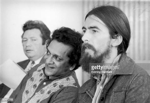 Singersongwriter George Harrison former member of The Beatles at the Royal Festival Hall with Indian sitar maestro Ravi Shankar during the time...