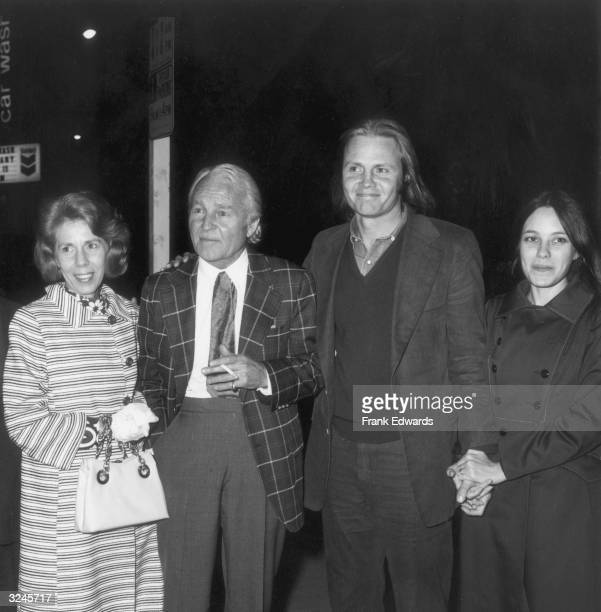 American actor Jon Voight stands outdoors with his wife actor Marcheline Bertrand and his parents at a screening of director Martin Ritt's film 'Pete...