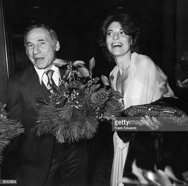 American actor and director Mel Brooks carries pine branches and holly while walking with his wife the American actor Anne Bancroft at a TV Academy...
