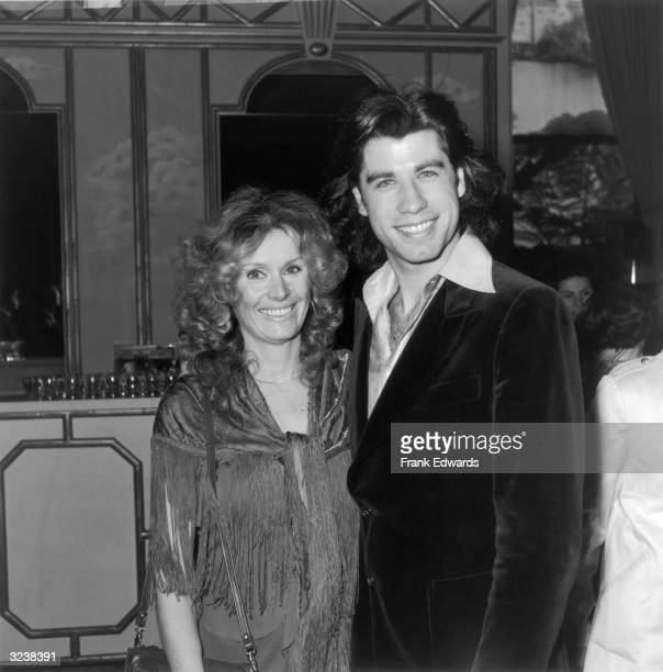 American actors John Travolta and Diana Hyland smile as they pose together at the 36th Annual Golden Apple Awards at the Beverly Wilshire Hotel,...