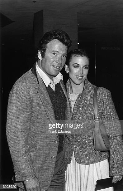 Canadianborn actor William Shatner smiles while standing with his arm around his second wife actor Marcy Lafferty at a party in the Century Plaza...