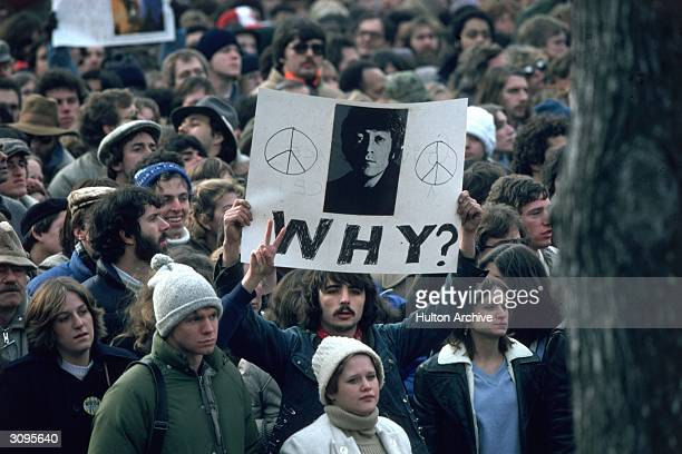 Fans of John Lennon holding a vigil after he was shot dead by a fan on December 8th at his home in New York