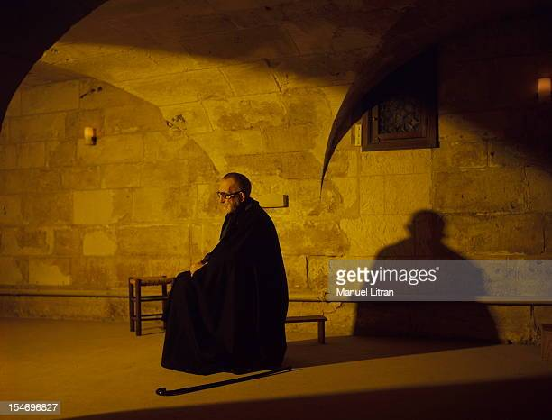 December 1985 Abbe Pierre staying at the Benedictine Abbey of St Wandrille near CaudebecenCaux the Abbe profile praying or meditating in a room of...