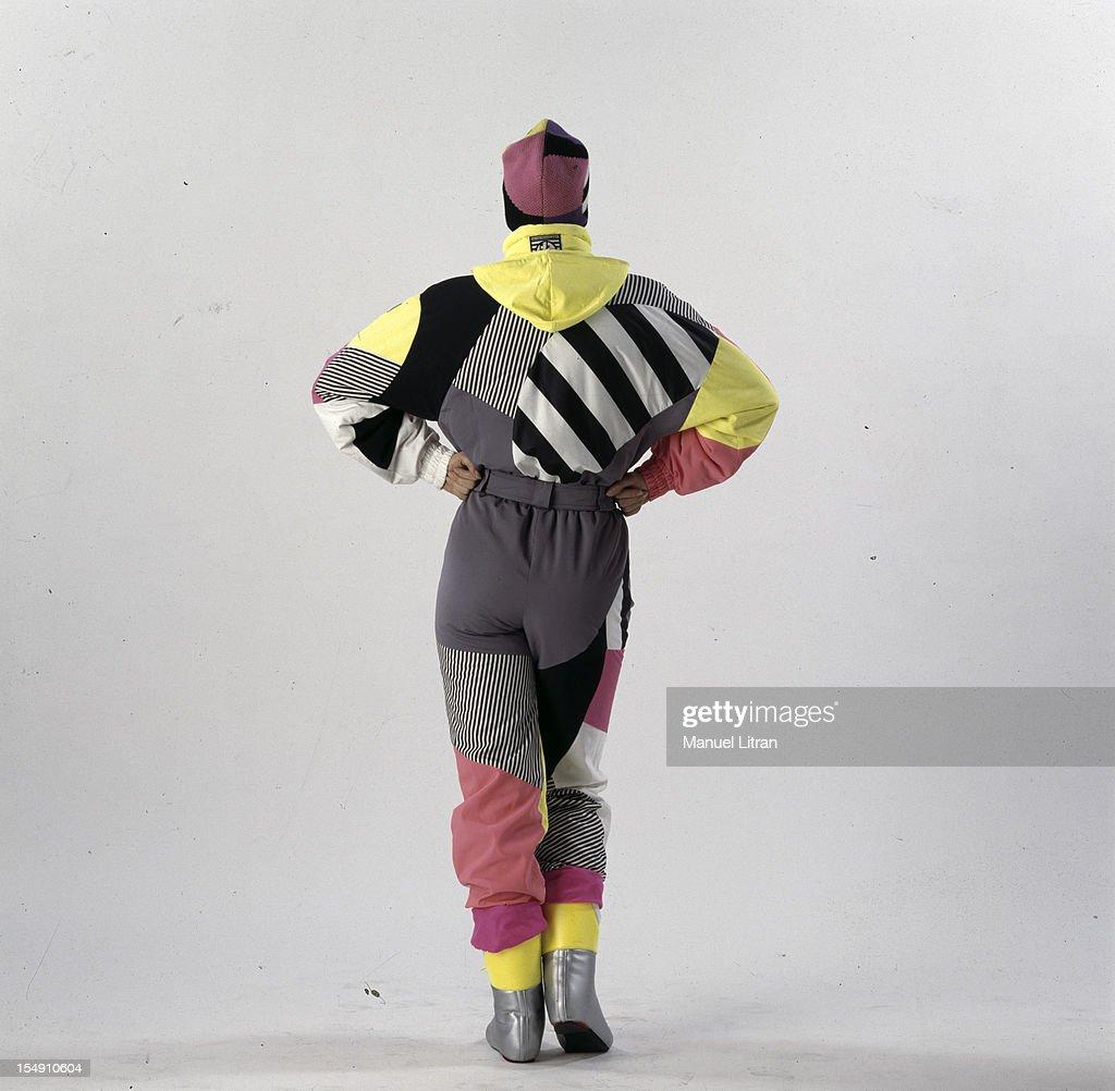 a model wearing a ski suit and matching hat multicolored (Henri Duvillard).