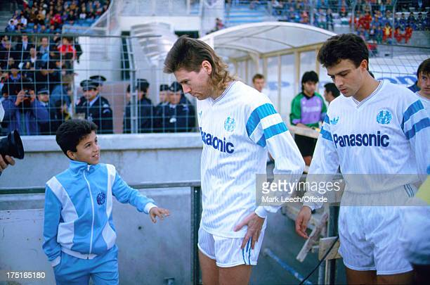 17 December 1989 French Football Marseille v Nice a young Marseille ball boy looks up at Chris Waddle as he appears from the players tunnel