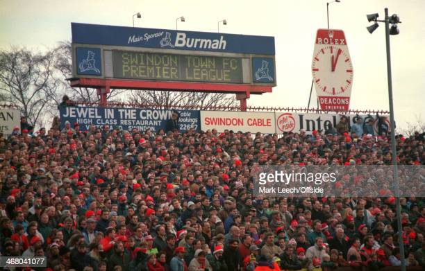 December 1993 Premier League Football - Swindon Town v Arsenal, Standing supporters are packed on the open terrace at the County Ground, where the...