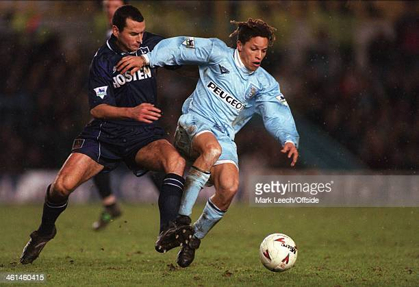 December 1994 English Football League Division One - Coventry City v Tottenham Hotspur, Colin Calderwood challenges Cobi Jones of Coventry.