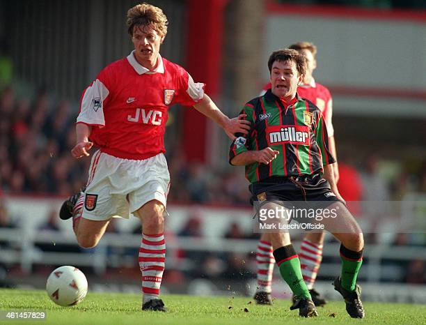 26 December 1994 FA Premier League Football Arsenal v Aston Villa Stefan Schwarz is beaten to the ball by Ray Houghton of Villa