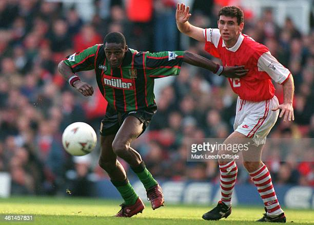 26 December 1994 FA Premier League Football Arsenal v Aston Villa Villa striker John Fashanu gets away from Martin Keown