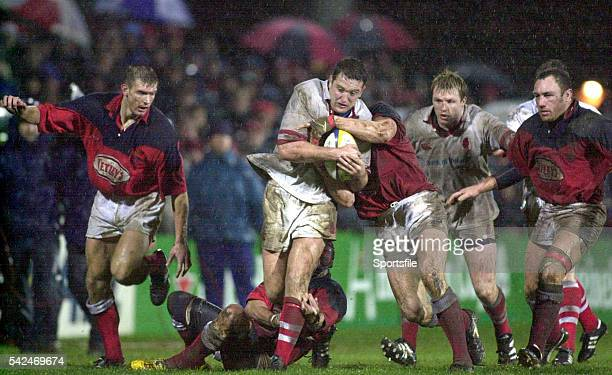 December 1999; Mark Blair, Ulster, is tackled by Daffyd James and Simon Easterby, Llanelli. Heineken European Cup, Ulster v Llanelli, Ravenhill,...