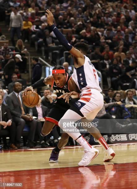 TORONTO ON December 20 In first half action Toronto Raptors forward Rondae HollisJefferson makes a move around Washington Wizards guard Troy Brown Jr...