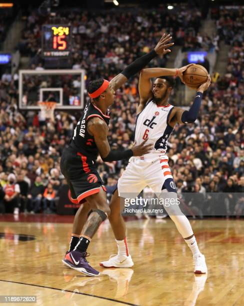 TORONTO ON December 20 In second half action Toronto Raptors forward Rondae HollisJefferson works some defence on Washington Wizards guard Troy Brown...