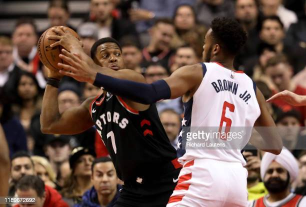 TORONTO ON December 20 In second half action Toronto Raptors guard Kyle Lowry looks for a pass around Washington Wizards guard Troy Brown Jr The...