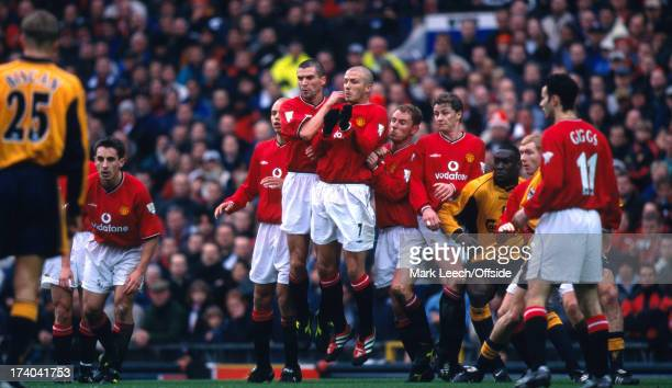 December 2000 Premiership Football Manchester United v Liverpool Roy Keane and David Beckham jump together in the United defensive wall which aslso...