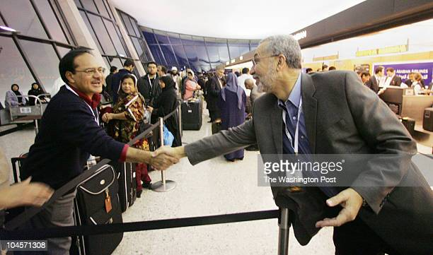 December 2006 CREDIT TRACY A WOODWARD / TWP Dulles International Airport Saudi Airlines Counter Safi Khan the imam of DarUsSalaam in College Park is...