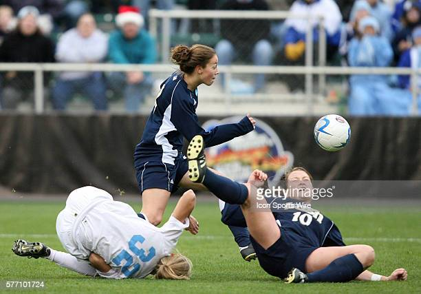 Notre Dame's Kerri Hanks chases the ball after a collision sent teammate Brittany Bock and North Carolina's Kristi Eveland tumbling The University of...