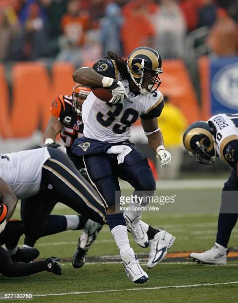 St Louis Rams runningback Steven Jackson against the Cincinnati Bengals' Dexter Jackson in their NFL game at Paul Brown stadium in Cincinnati Ohio