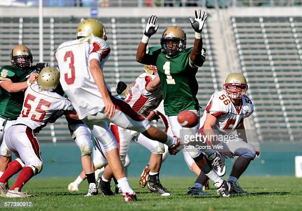 St Bonaventure Patrick Hall rushes in attempt to block the punt by Cardinal Newman Randy Wright during the CIF State Football Championships Division...